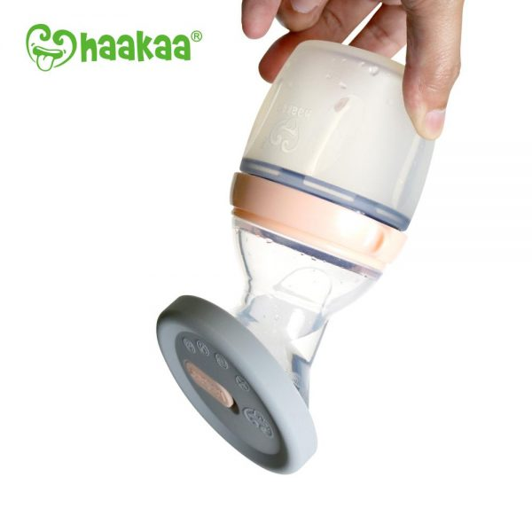 Haakaa Silicone Breast Pump Cap in use